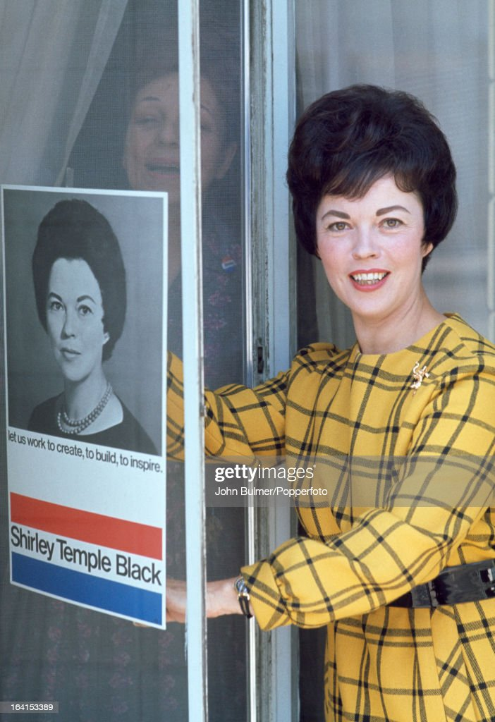 American former child actress <a gi-track='captionPersonalityLinkClicked' href=/galleries/search?phrase=Shirley+Temple&family=editorial&specificpeople=69996 ng-click='$event.stopPropagation()'>Shirley Temple</a> with a poster from her United States House of Representatives election campaign as <a gi-track='captionPersonalityLinkClicked' href=/galleries/search?phrase=Shirley+Temple&family=editorial&specificpeople=69996 ng-click='$event.stopPropagation()'>Shirley Temple</a> Black, USA, 1968.