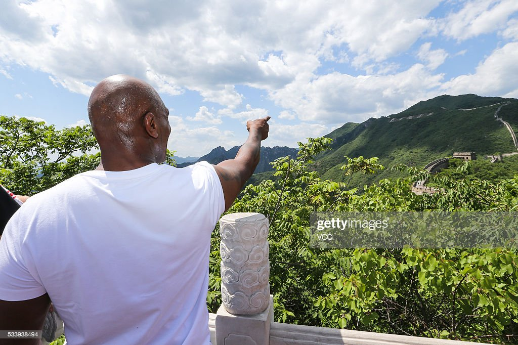 American former professional boxer <a gi-track='captionPersonalityLinkClicked' href=/galleries/search?phrase=Mike+Tyson&family=editorial&specificpeople=194986 ng-click='$event.stopPropagation()'>Mike Tyson</a> points fa distance on the Great Wall during the Weigh-in of IBF World Boxing Championship Bout at Mutianyu on May 24, 2016 in Beijing, China.