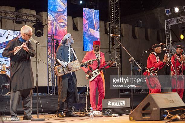 American free jazz bassist Jamaaladeen Tacuma and Maalem Hassan Boussou performs on the stage during 19th Annual Gnaoua Music Festival at Moulay...