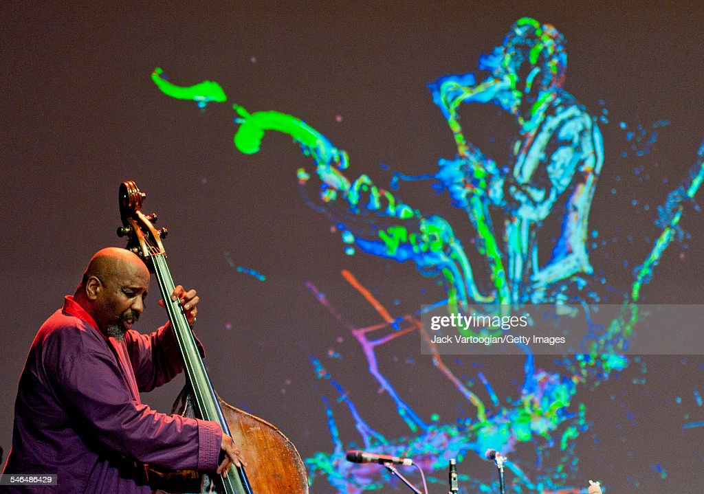 American Free Jazz musician <a gi-track='captionPersonalityLinkClicked' href=/galleries/search?phrase=William+Parker+-+Musician&family=editorial&specificpeople=15370335 ng-click='$event.stopPropagation()'>William Parker</a> plays upright acoustic bass with the Peter Brotzmann Quartet at the 'Peter Brotzmann: A Lifetime of Achievement' concert during Vision Festival 16 'Take A Stand' in the Abrons Art Center's Playhouse Theater, New York, New York, June 8, 2011. The projected image is a drawing by artist Jeff Schlanger.