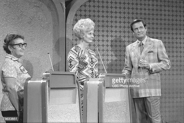 American game show host Bob Barker and two unidentified contestants listen to an unseen announcer during the final 'Showcase Showdown' portion of the...