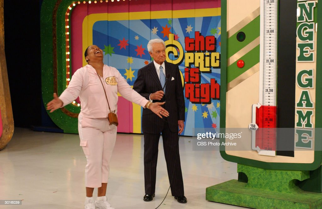 American game show host Bob Barker celebrates with contestant Maxine Bryant after winning 'The Range Game' during the taping of the 6000th episode of...
