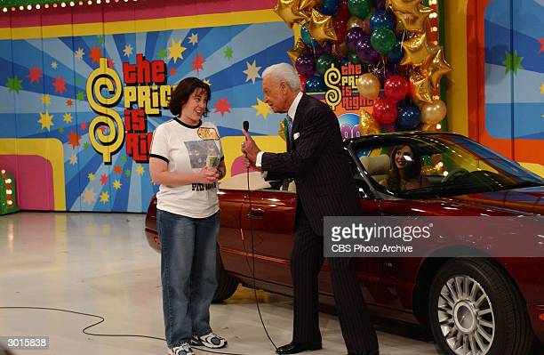 American game show host Bob Barker speaks to contestant Amy Rempel who bids on a new car on the television show 'The Price Is Right' during the...