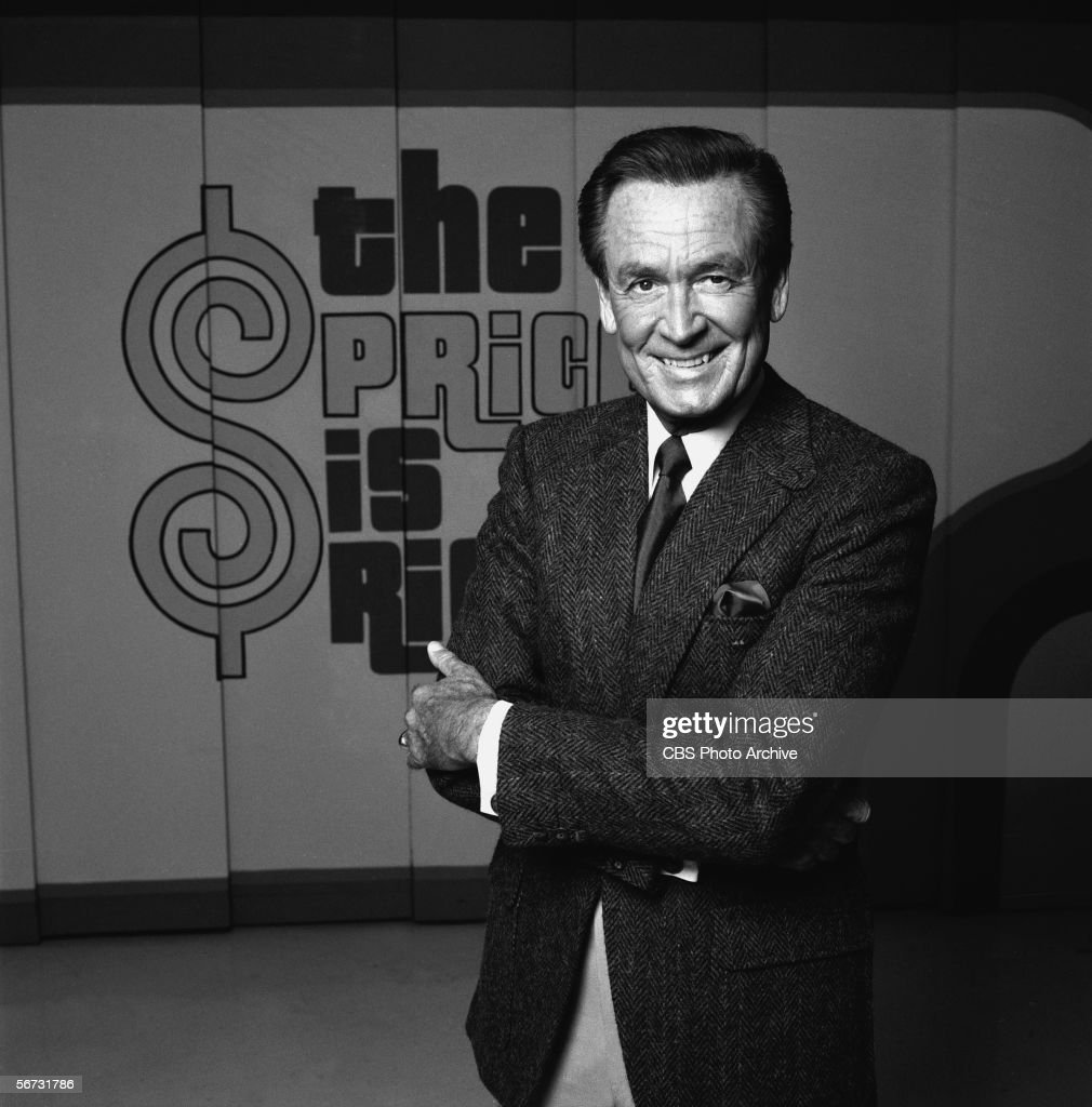 American game show host Bob Barker stands and smiles with arms crossed on the set of his 'The Price is Right' The Bob Barker Studio CBS Television...