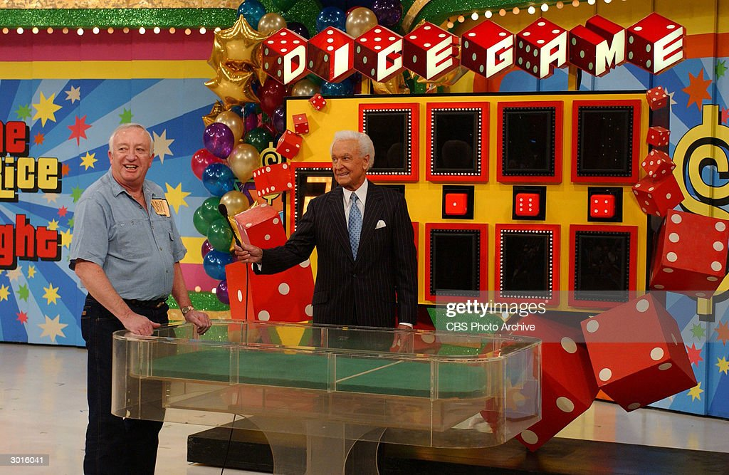 American game show host Bob Barker talks to a contestant on the set of the 'The Price Is Right' during the taping of the 6000th episode The show is...