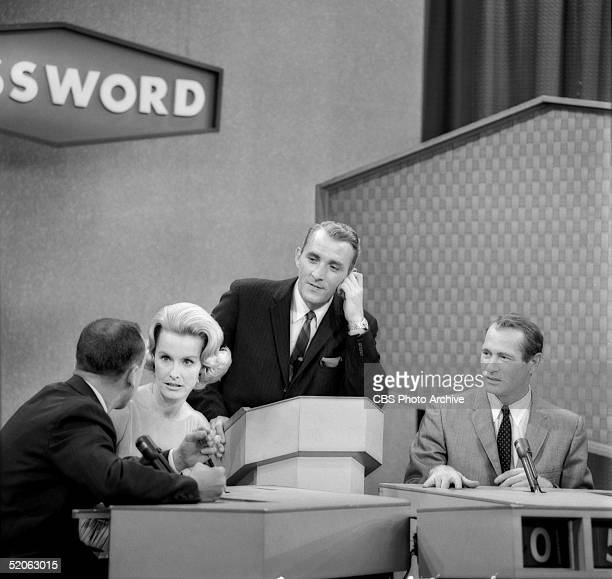American game show host Jack Clark and American actor Darren McGavin listen as American actress Dina Merrill and an unidentified contestant try to...