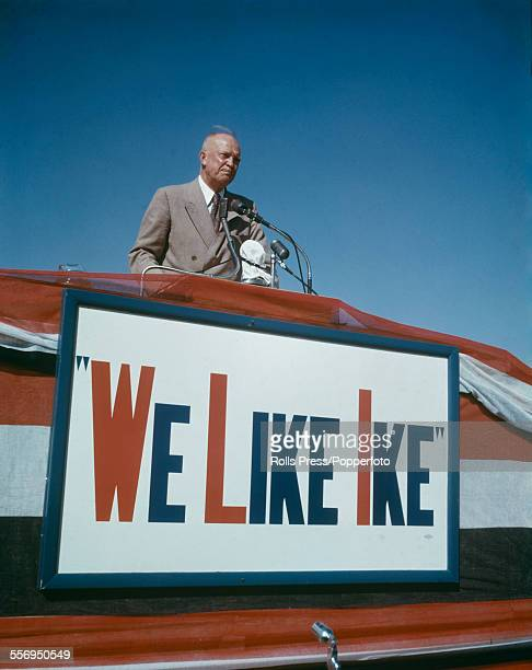 American General Dwight D Eisenhower speaks on a podium above a sign declaring 'We Like Ike' during his presidential election campaign in Lubbock...
