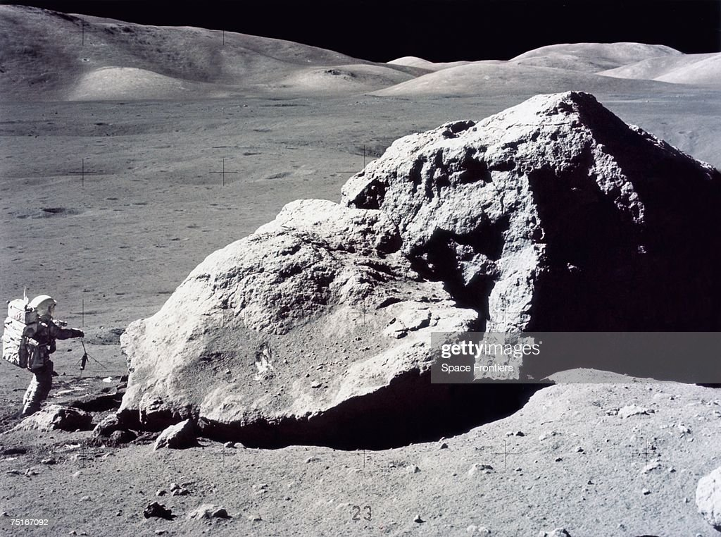 American geologist and astronaut Harrison Hagan Schmitt takes rock samples from the surface of the moon during America's last lunar landing mission of the 20th century, Apollo 17, December 1972.