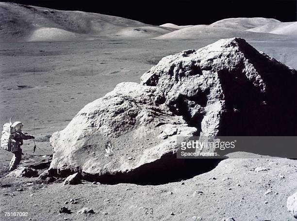 American geologist and astronaut Harrison Hagan Schmitt takes rock samples from the surface of the moon during America's last lunar landing mission...