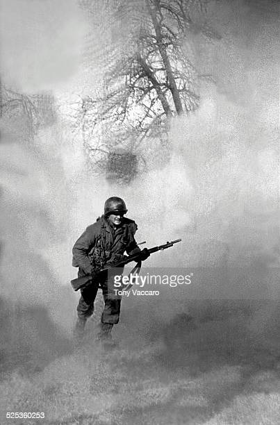 American GI Ivan Parrott is seen running through smoke in no mans land near Neuss Germany during the Battle for the Rhine World War II 1st March 1945