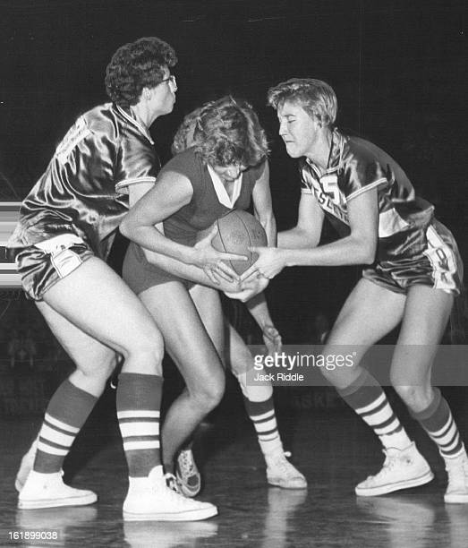1291959 DEC 10 1959 DEC 13 1959 American girl basketball players Barbara Sipes and Carolyn Miller two time Russia's Galina Kuznetsova in an attempt...