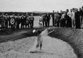 American golfer Arnold Palmer drives out of a sand trap during the British Open Championship on the St Andrews course while spectators watch St...