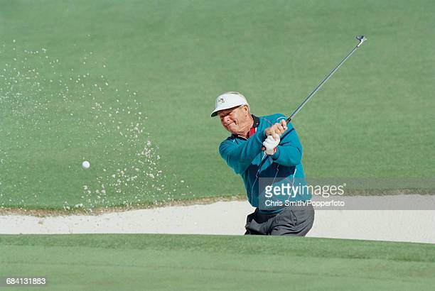 American golfer Arnold Palmer pictured in action in competition to miss the cut in the 1994 Masters golf tournament at Augusta National Golf Club in...