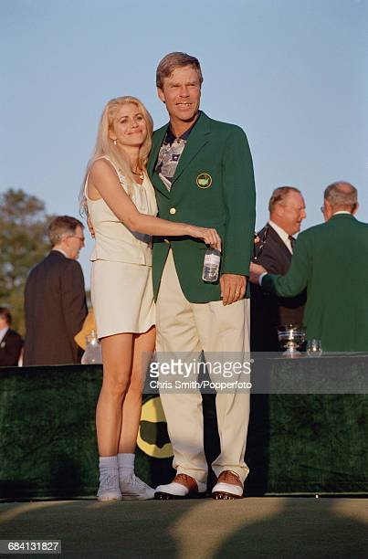 American golfer Ben Crenshaw hugs his wife Julie Crenshaw afer being presented with his green jacket by the previous year's winner Spanish golfer...
