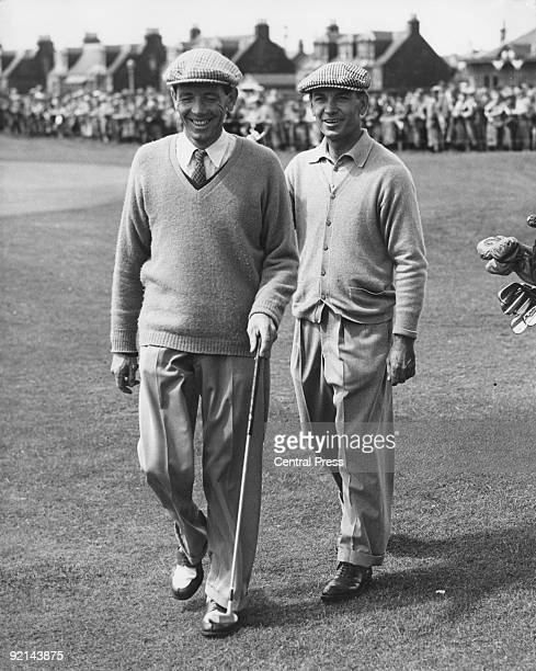 American golfer Ben Hogan pats W J Branch on the back as they leave the 18th green at the end of their qualifying rounds in the Open Golf...