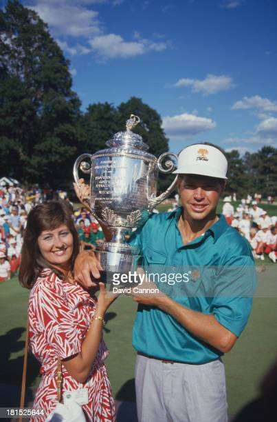 American golfer Bob Tway and his wife Tammie with the trophy after Tway won the PGA Championship at Inverness Club in Toledo Ohio 11th August 1986...