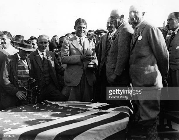 American golfer Bobby Jones centre is presented with the trophy on winning the British Open Golf Championship at St Anne's