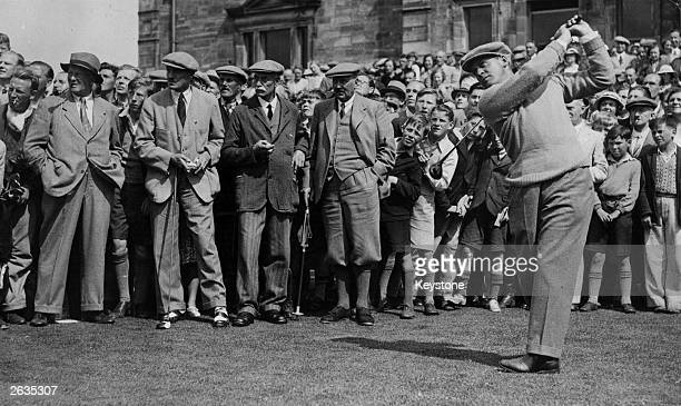 American golfer Bobby Jones driving off at St Andrews while a large crowd of admirers gathers behind him Jones won the British Open three times and...