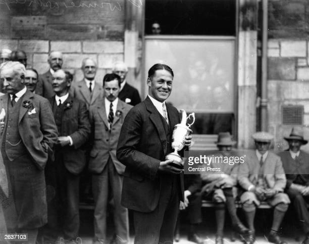 American golfer Bobby Jones holding the trophy after winning the 1927 Open Golf Championship at St Andrews Jones won the British Open three times and...