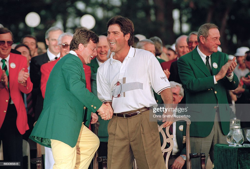 American golfer Fred Couples pictured right shaking hands with the previous year's winner, Welsh golfer Ian Woosnam at the green jacket presentation ceremony after finishing in first place by two strokes to win the 1992 Masters Tournament at Augusta National Golf Club in Augusta, Georgia on 12th April 1992.