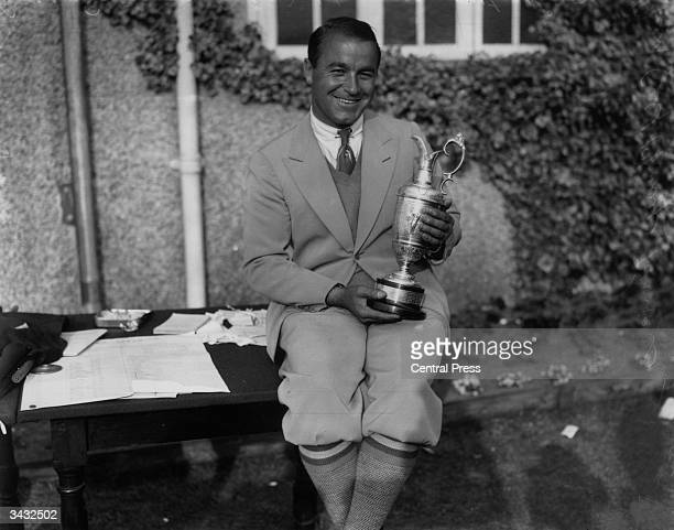 American golfer Gene Sarazen with a trophy at the British Open Golf Championships at Princes Course Sandwich