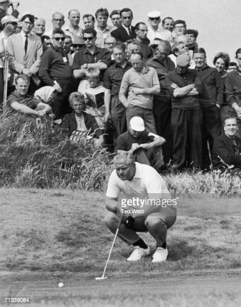 American golfer Jack Nicklaus lines up his putt on the fourthe green at the British Open Golf Championships at Hoylake 13th July 1967