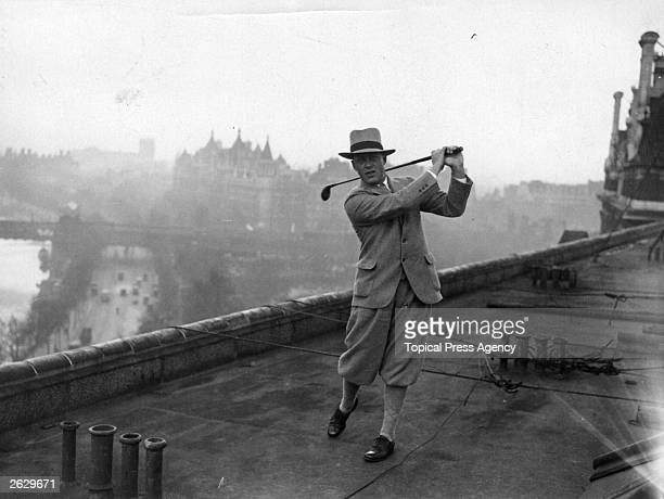 American golfer Robert Tyre best known as Bobby Jones practising his swing on the roof of the Savoy Hotel in London Jones is one of the American...