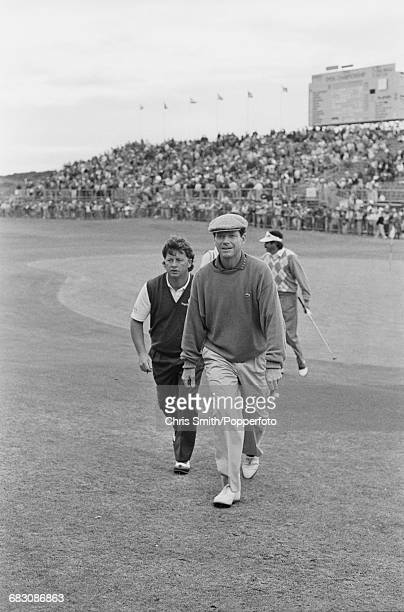 American golfer Tom Watson and Welsh golfer Ian Woosnam pictured together walking off a green during competition in the 1991 Open Championship at...