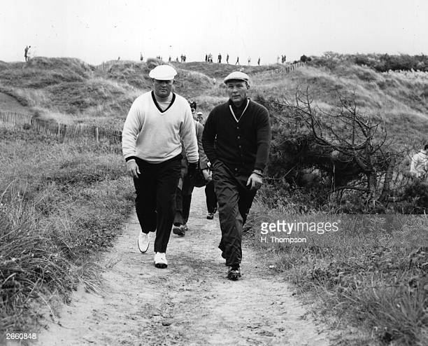 American golfers Jack Nicklaus and Arnold Palmer walk together during a practice round of golf England July 6 1965