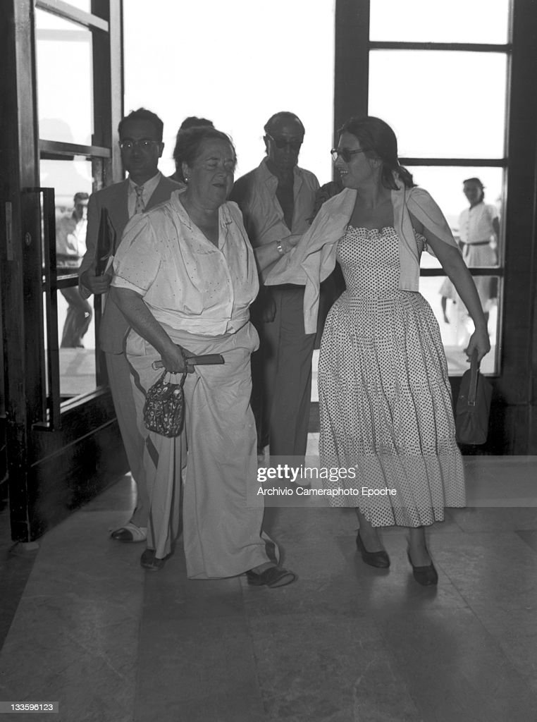 American gossip columnist Elsa Maxwell getting in the Excelsior hotel with Anna Magnani Lido Venice 1948