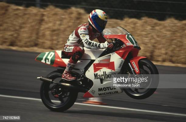 American Grand Prix motorcycle road racer John Kocinski rides the 250cc MarlboroYamaha YZR250 to finish in first place to win the 1990 Belgian...