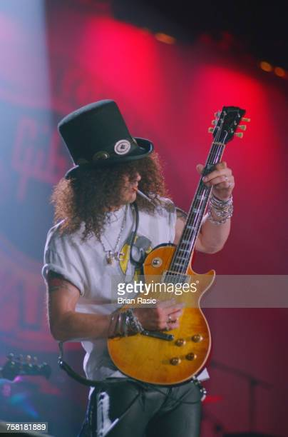 American guitarist and musician Slash of rock group Guns N' Roses performs live playing his Gibson Les Paul guitar on stage at the Gibson Night of...