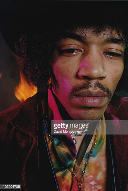 American guitarist and singer Jimi Hendrix photographed amid smoke and flames for his album 'Electric Ladyland' London 1968