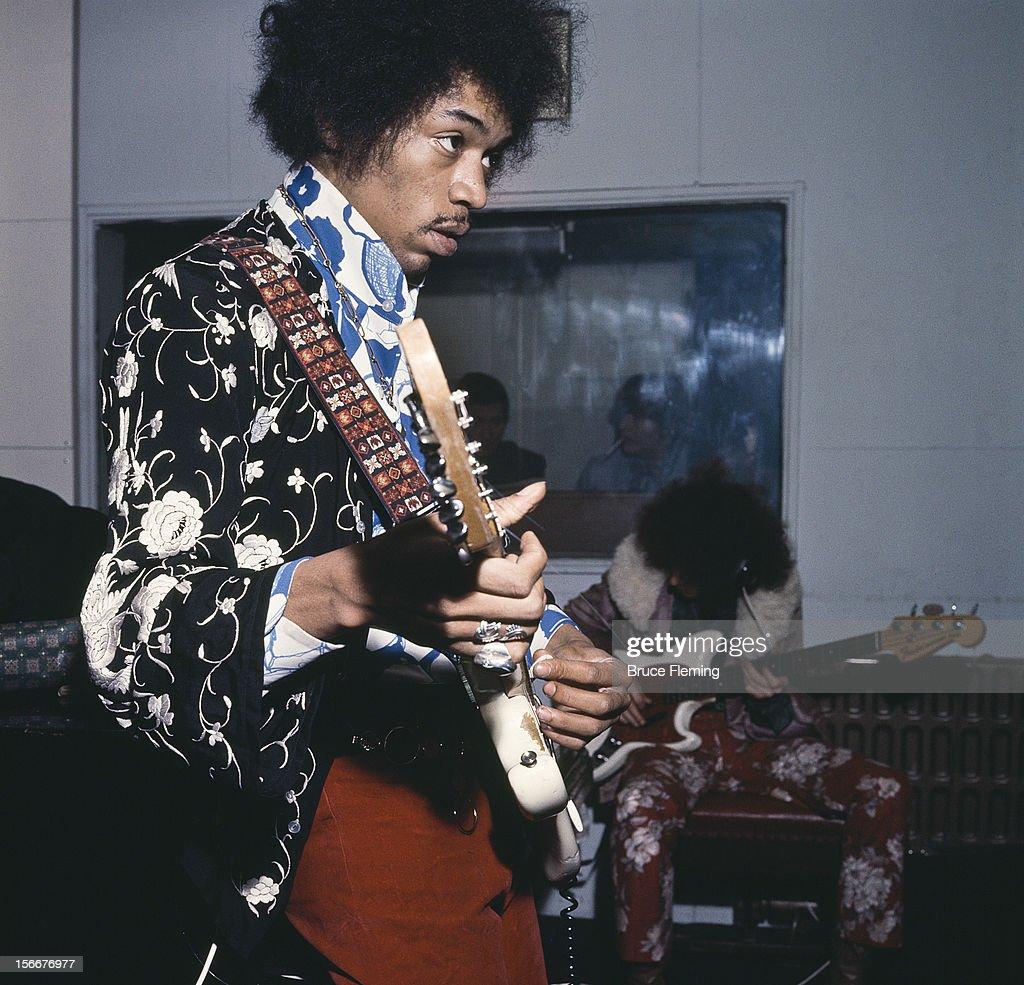 American guitarist Jimi Hendrix of The Jimi Hendrix Experience in a London recording studio October 1967 In the background is bassist Noel Redding