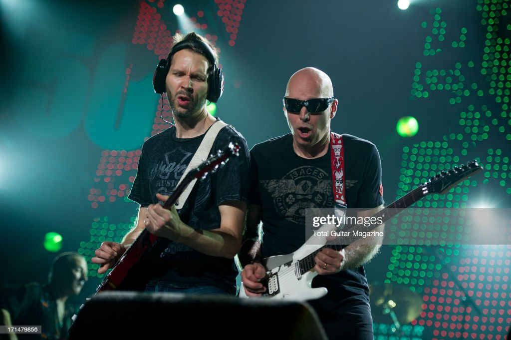 American guitarists Paul Gilbert (L) and <a gi-track='captionPersonalityLinkClicked' href=/galleries/search?phrase=Joe+Satriani&family=editorial&specificpeople=790021 ng-click='$event.stopPropagation()'>Joe Satriani</a> performing live onstage during the Marshall 50 Years of Loud Live anniversary concert at the Wembley Arena, September 22, 2012.
