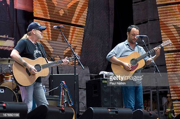 American guitarist/vocalists Greg Allman and Dave Matthews perform on stage at the 22nd Annual Farm Aid concert Randall's Island New York New York...