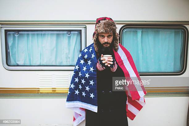 American guy on camping with USA flag
