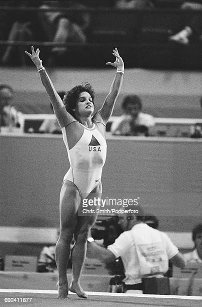 American gymnast Mary Lou Retton competes in the compulsory floor exercise during competition in the Women's artistic individual allaround event at...
