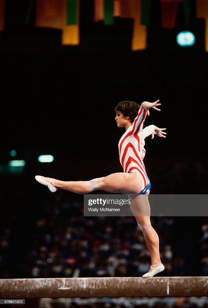 American gymnast Mary Lou Retton performs on the balance beam during the finals of the women's gymnastic team event at the 1984 Los Angeles Summer Olympic Games.