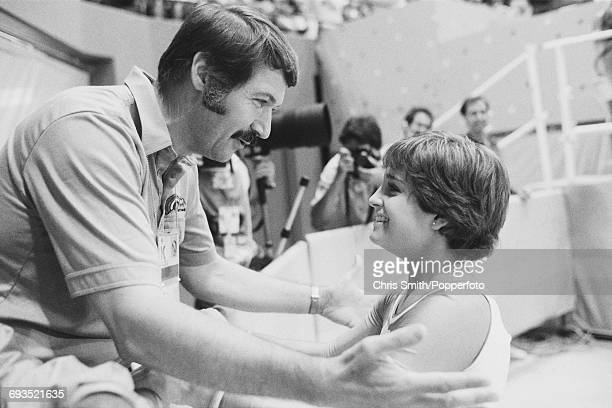 American gymnast Mary Lou Retton pictured being congratulated by US women's gymnastics coach Bela Karolyi during competition in the Women's artistic...