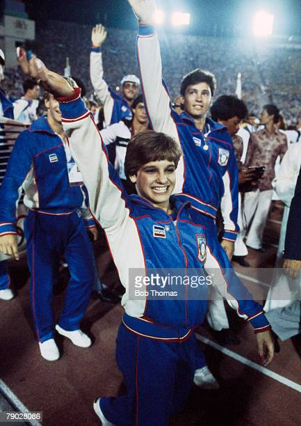 American gymnast Mary Lou Retton pictured front with fellow United States team members as they parade around the athletics track inside the Memorial...