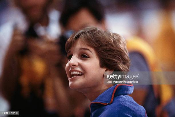 American gymnast Mary Lou Retton smiles after finishing in first place to win the gold medal in the Women's artistic individual allaround event at...