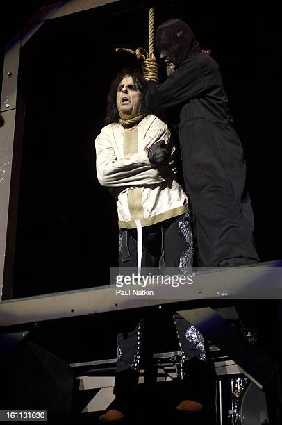 American heavy metal singer Alice Cooper and an unidentified 'hangman' perform at the Sears Centre in Hoffman Estates Illinois September 22 2007
