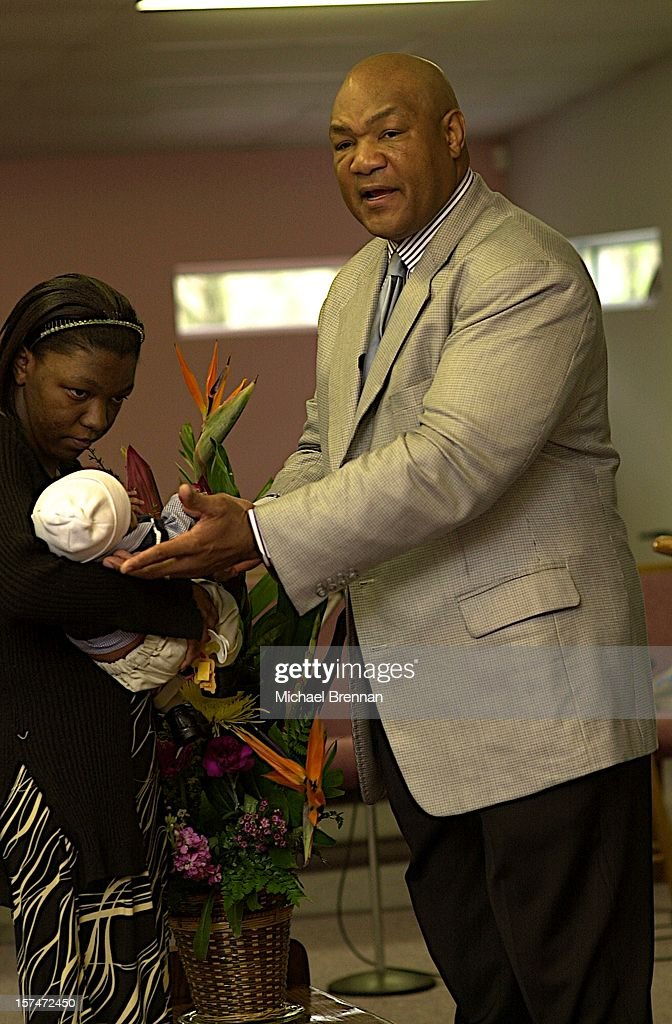 American heavyweight boxer George Foreman officiates at the baptism of a child at The Church Of The Lord Jesus Christ on Lone Oak Road in Houston, Texas, March 2003. Foreman became a born-again Christian and ordained minister in 1977.