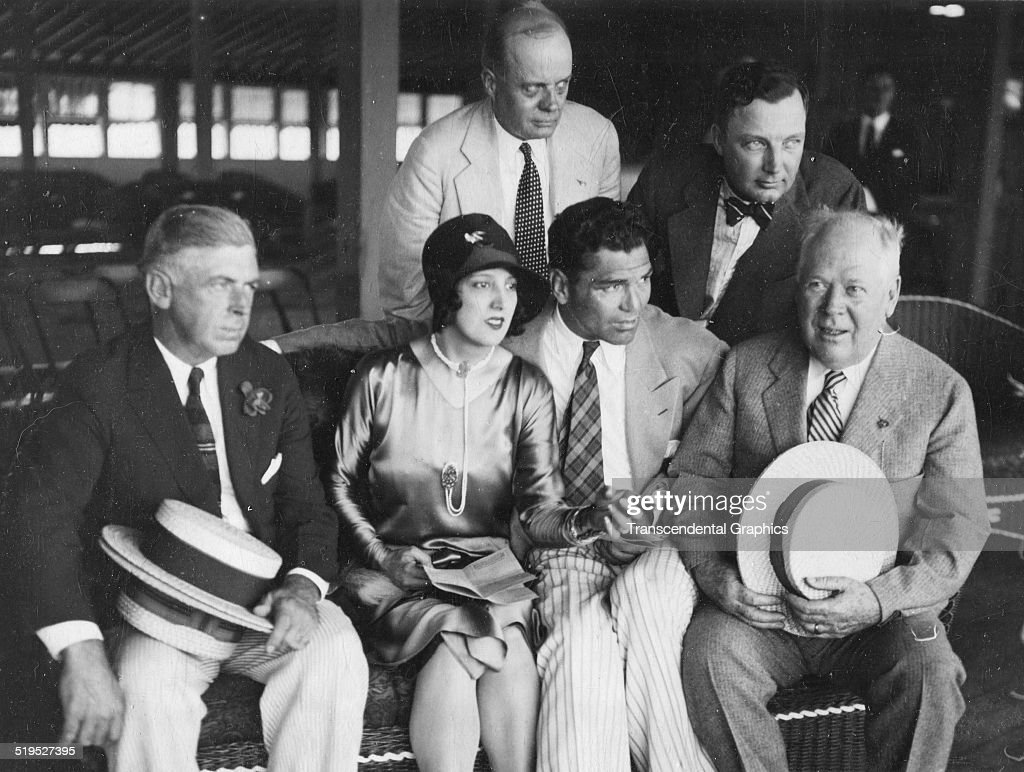 American heavyweight boxer <a gi-track='captionPersonalityLinkClicked' href=/galleries/search?phrase=Jack+Dempsey+-+Boxer&family=editorial&specificpeople=15348667 ng-click='$event.stopPropagation()'>Jack Dempsey</a> (1895 - 1983) (front row, second right) sits with unidentified others at the Washington Park Race Track, Chicago, Illinois, 1927.