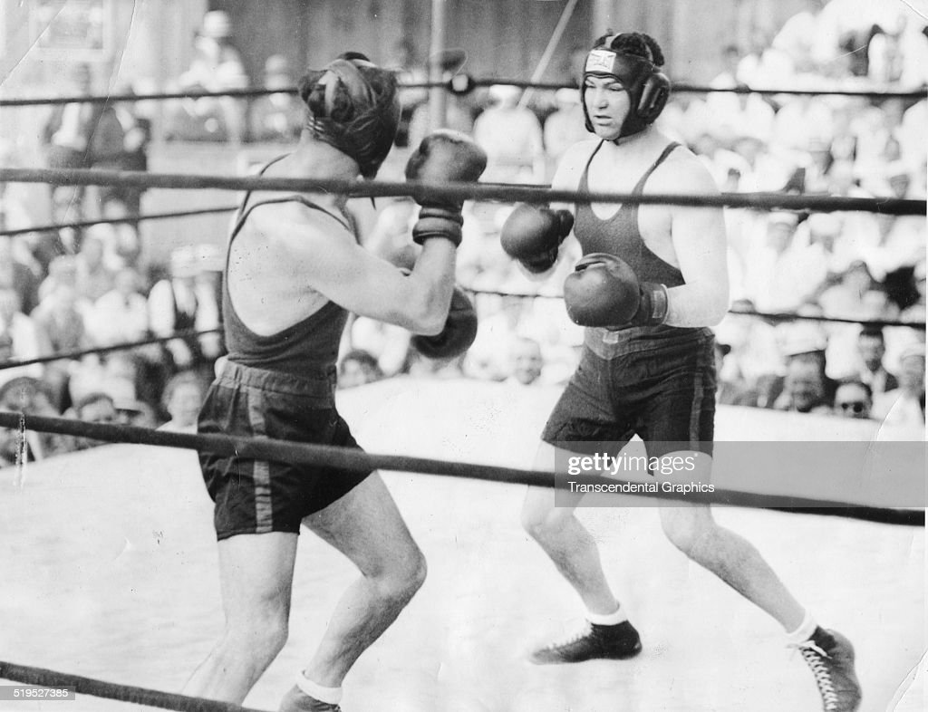 American heavyweight boxer <a gi-track='captionPersonalityLinkClicked' href=/galleries/search?phrase=Jack+Dempsey+-+Boxer&family=editorial&specificpeople=15348667 ng-click='$event.stopPropagation()'>Jack Dempsey</a> (1895-1983) (right) spars with German heavyweight Max Schmelling (1905 - 2005) during an exhibition bout at Schmeling's training camp, Swannoa, New Jersey, May 27, 1933.