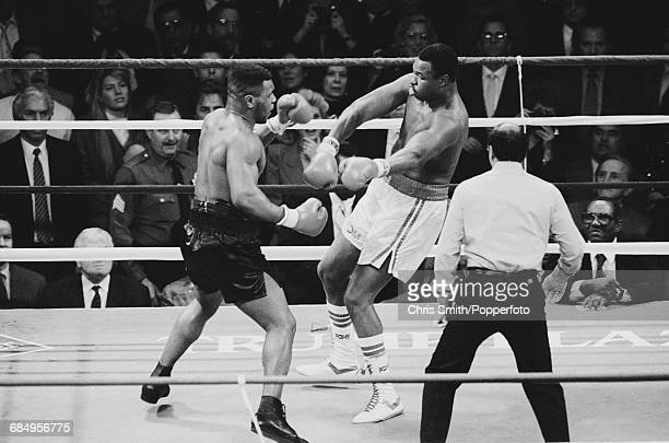 American heavyweight boxer Mike Tyson pictured left in action in his heavyweight title fight with Larry Holmes at the Convention Hall in Atlantic...