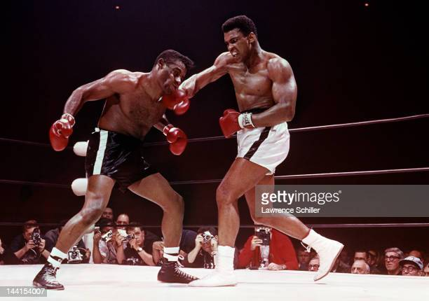 American heavyweight boxer Muhammad Ali hits Floyd Patterson during a bout at the Convention Center Las Vegas Nevada November 22 1965 Ali went on to...