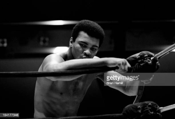 American heavyweight boxer Muhammad Ali leans on the ropes during a training session mid to late 20th century