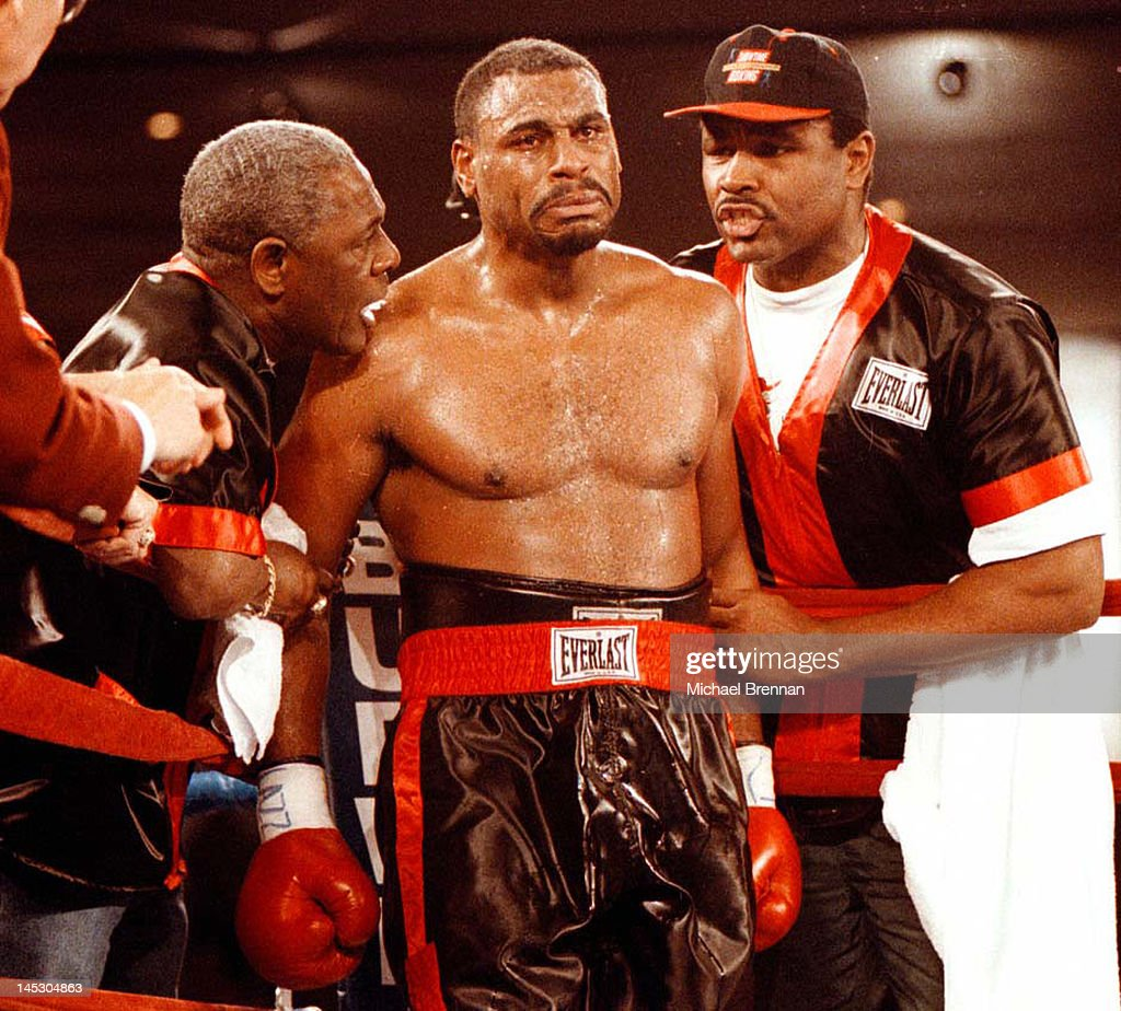 American Heavyweight boxer Oliver McCall is flanked by his trainers George Benton (left) and <a gi-track='captionPersonalityLinkClicked' href=/galleries/search?phrase=Greg+Page&family=editorial&specificpeople=730956 ng-click='$event.stopPropagation()'>Greg Page</a> as he heads for the fourth round against Lennox Lewis at the Hilton Hotel, Las Vegas, 7th February 1997. He lost the match for the WBC heavyweight title.